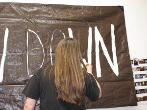 "Painting the ""I Should Slow Down"" banner"